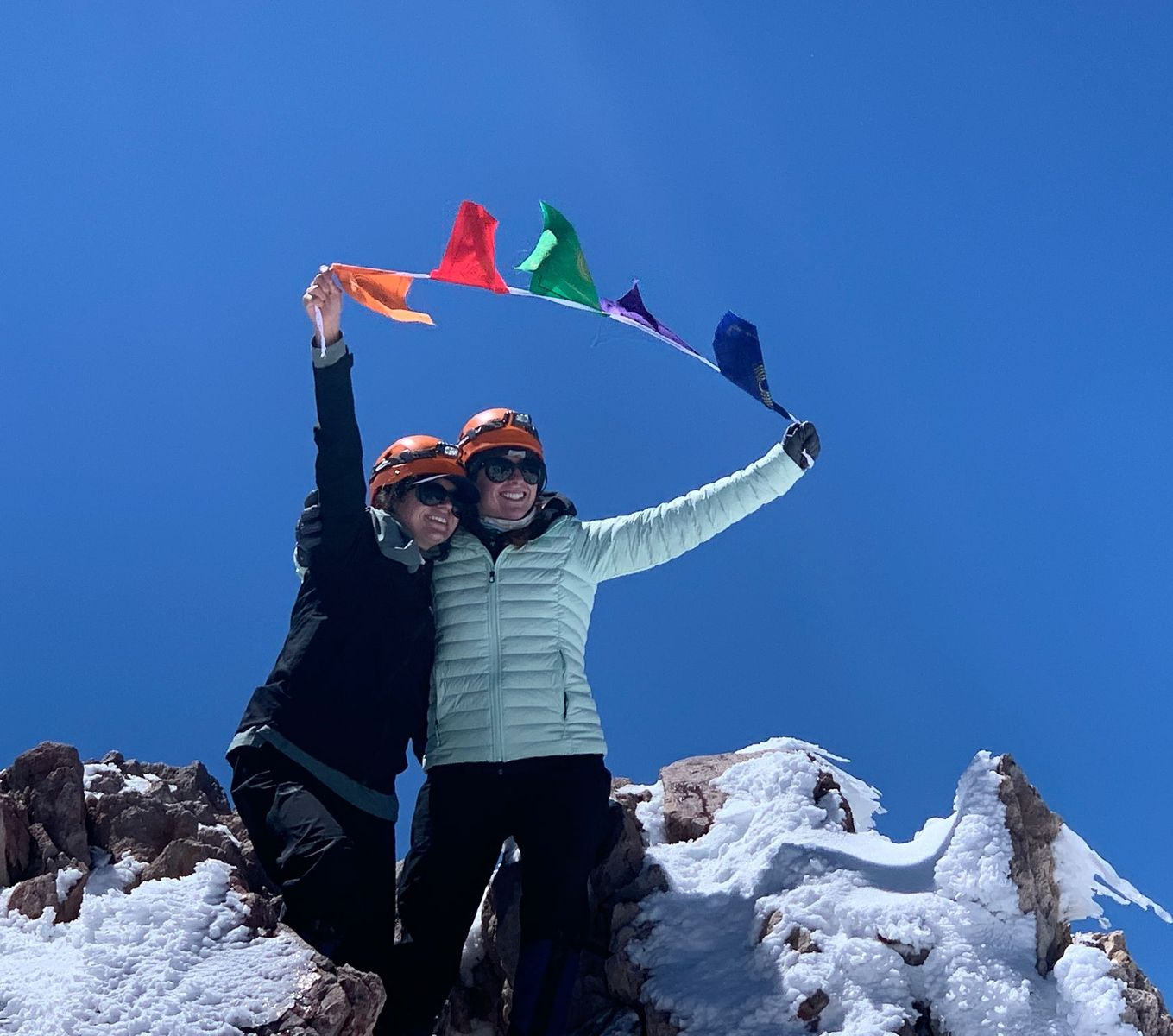 Bridget Vanoni and Kayla Field summit Mt Shasta Climb Against the Odds Breast Cancer Prevention Partners
